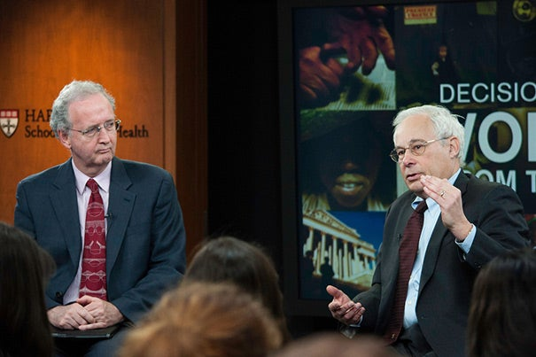 """""""You can't ask a kid to be healthy and exercise if he can't safely stand on the front porch, never mind run down the street,"""" said Donald Berwick (right), a lecturer at Harvard Medical School. His talk was sponsored by the Harvard School of Public Health's Voices from the Field program, and was hosted by John McDonough (left), professor of the practice of public health."""