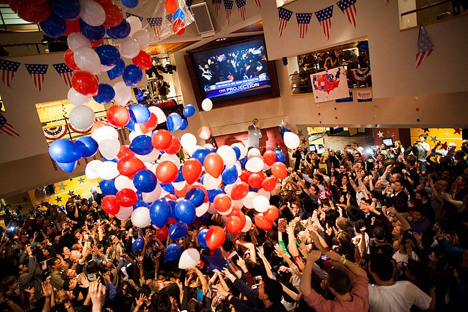 Students, faculty, and community members gathered at the Forum to watch coverage of the 2012 election. Balloons fell on the crowd when the presidential winner was announced. Stephanie Mitchell/Harvard Staff Photographer