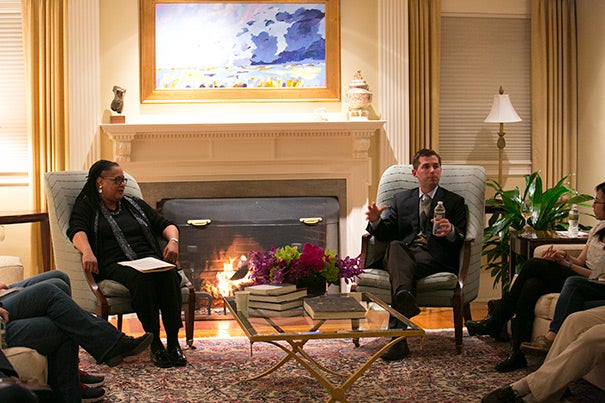 Professor Matthew Nock (right), Harvard College Dean Evelynn M. Hammonds, and 20 students gathered at Hammonds' home for a fireside chat. The event was the second in a new series meant to connect undergraduates with faculty members in an open, informal, and welcoming atmosphere.