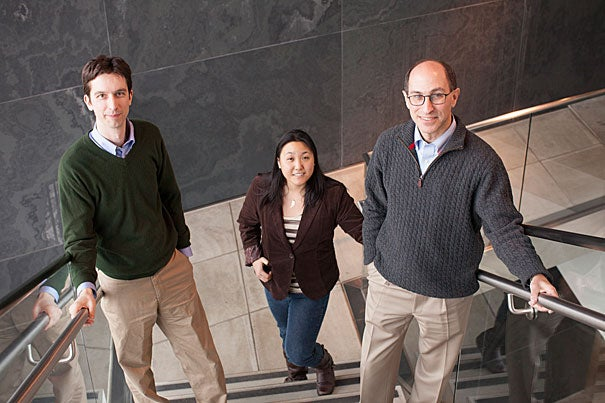 Researcher Peter Turnbaugh (left) and Associate Professor of Medicine Lee Kaplan (right) are the senior authors on a paper detailing drastic changes in the gut microbes of mice following gastric bypass surgery. The pair are pictured with Alice Liou, a research fellow in medicine at Harvard Medical School, who was also part of the research team.