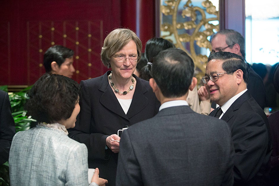 Harvard President Drew Faust and Victor Fung (right), group chairman of Li & Fung Group, discuss edX with other business and administration leaders in Hong Kong.