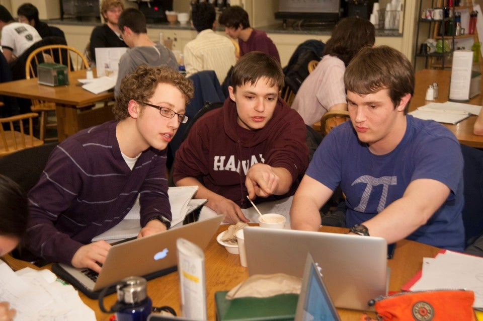 Aaron Markowitz '16 (from left), George Torres '16, and Roman Berens '16 focus on their physics work.
