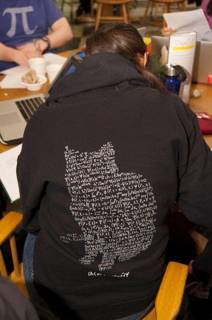 Cyndia Yu sports a sweatshirt decorated with Schrödinger's cat, a thought experiment devised by Austrian physicist Erwin Schrödinger in 1935.