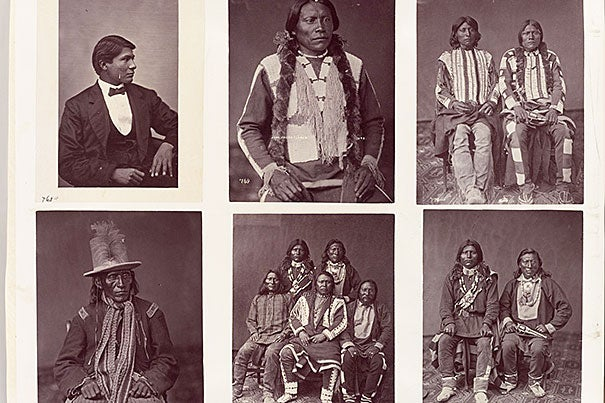 A typical album page, showing mixed clothing styles. These are Ute Indians from the Yampah, Muache, and Tareguache bands. Sequence 262, Vol. 2. Undated.