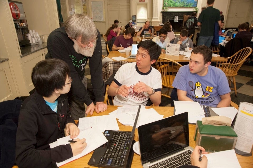 House Master Howard Georgi offers some advice to Paul Wei '15 (center) and Leo Guttmann '15 (right).