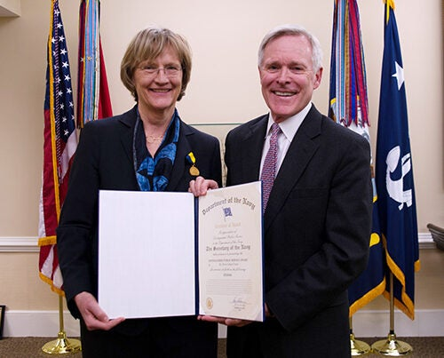 "President Drew Faust was presented with the Navy Distinguished Public Service Award, its highest civilian honor. ""I am proud of the renewed relationship that we have established with ROTC, and am deeply grateful for the men and women, some of them our students, who heed the call to public service by serving in our armed forces,"" said Faust. Presenting the award was Navy Secretary Ray Mabus (right)."