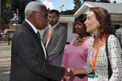 Tanzanian Vice President Mohamed Gharib Bilal greets Harvard School of Public Health's Ana Langer. Langer collaborated on a maternal health manifesto that was published in The Lancet on Feb. 22.