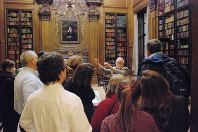 Fred Burchsted, a research librarian in Widener Library, addresses a tour of parents and family members in the Harry Elkins Widener Memorial Room, which houses the Harry Elkins Widener collection, including Harvard's Gutenberg Bible.