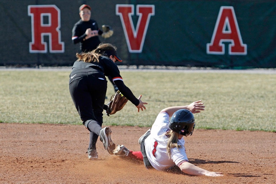 Stephanie Regan '13 slides safely beneath the tag at second base. Regan was 3-for-6 with four runs for the day.