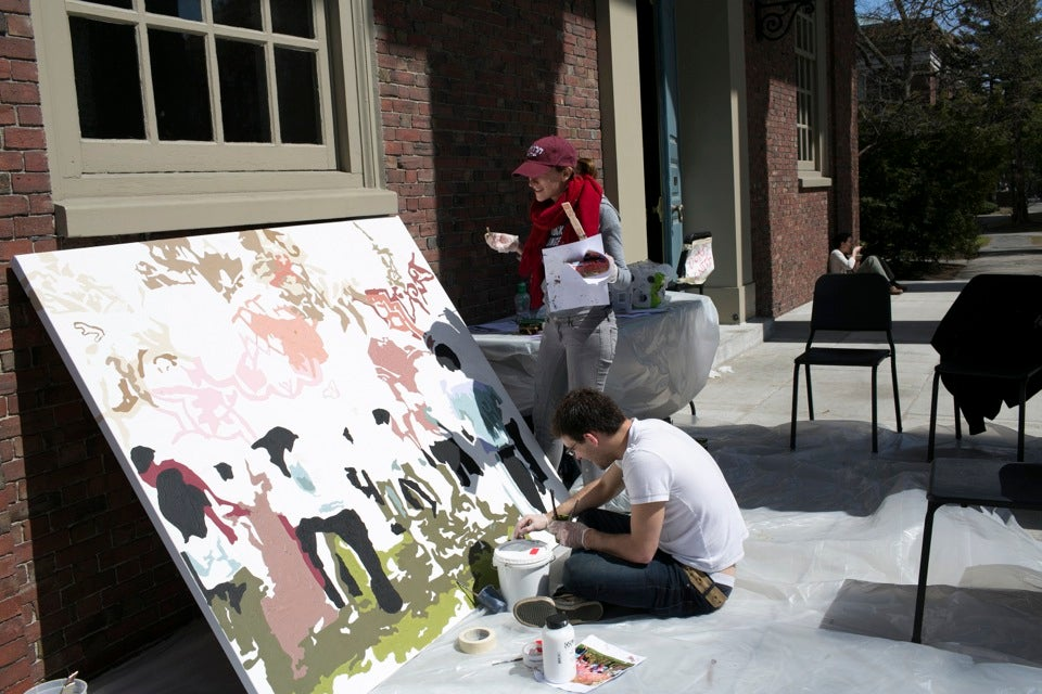 Gilon (standing) works with Gary Carlson '13 on a mural of the Holi festival, a Hindu spring festival of colors.
