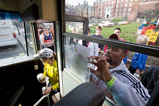 Before setting out for the Boston Marathon on Monday, Ali Evans '13 gathered students and checked his list as they boarded the bus to Hopkinton. Eight hours later, Harvard's running community would be pulled together for a different reason.