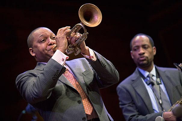 "Wynton Marsalis returned to Harvard to continue his two-year lecture series. He opened the evening by playing a piece that he had written earlier that day to commemorate the city's, and the country's, anguish over the bombings. ""Sometimes the expression of grief is such a heavy feeling that only playing will suffice,"" said Marsalis."
