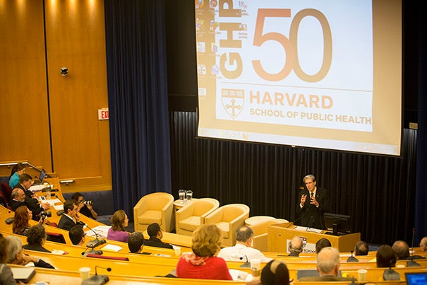 Harvard School of Public Health's Department of Global Health and Population took time to appreciate 50 years of advances during a daylong symposium. HSPH Dean Julio Frenk (at podium), who gave the welcoming remarks, pointed out that anniversaries are important occasions on which to not only reflect on the past, but also refocus on the future.