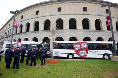 Members of the Harvard University Police Department gathered at Harvard Stadium to take shuttle buses to the memorial service for Sean Collier, the MIT police officer killed last week.