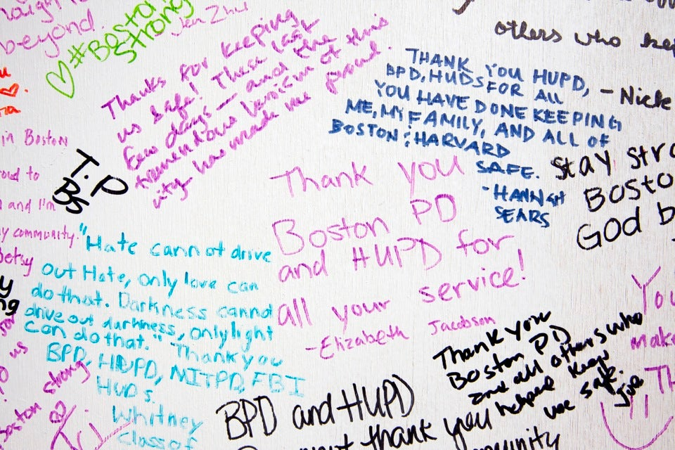 Passersby filled the boards with messages, thanks, and condolences.