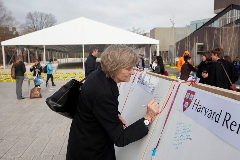 Harvard President Drew Faust signed the boards.