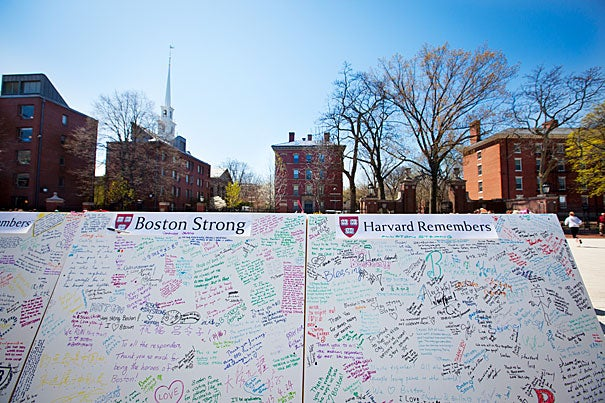 """Twenty stark whiteboards with the words """"Boston Strong"""" and """"Harvard Remembers"""" bannered across their tops appeared in the newly renovated plaza near the Science Center."""