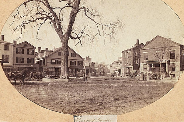 Harvard Square, looking south, circa 1860, albumen print. At left-center is Farwell's general store, built around 1800, and to the right, on the site of the present-day Harvard Coop, is Lyceum Hall. In the foreground, barely visible, are the rails of a horse-drawn streetcar line, Union Railway, which opened in 1854.