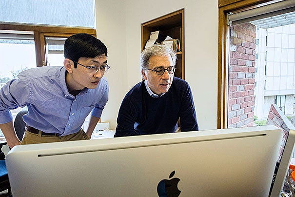 """""""It could eventually mean that instead of taking insulin injections three times a day, you might take an injection of this hormone once a week or once a month, or in the best case maybe even once a year,"""" said Doug Melton (right). Melton and postdoctoral fellow Peng Yi discovered the hormone betatrophin, which has the potential to improve diabetes treatment."""