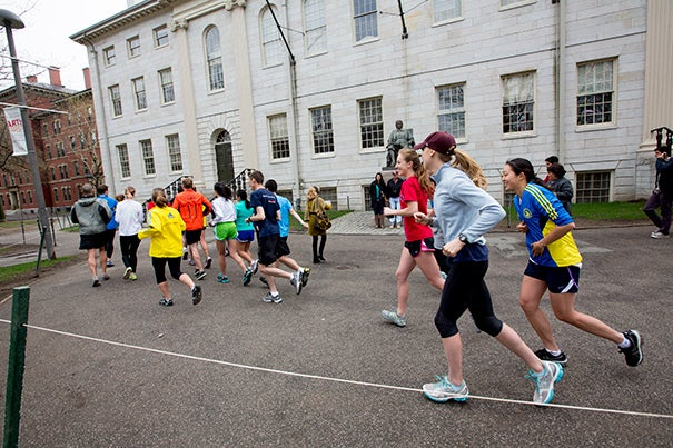 Saturday morning brought together a group of of 18 from the Harvard College Marathon Challenge to run from the John Harvard Statue to the Freedom Trail in Boston. The group made a detour to the makeshift memorial for slain MIT police officer Sean Collier, who was gunned down Thursday night.