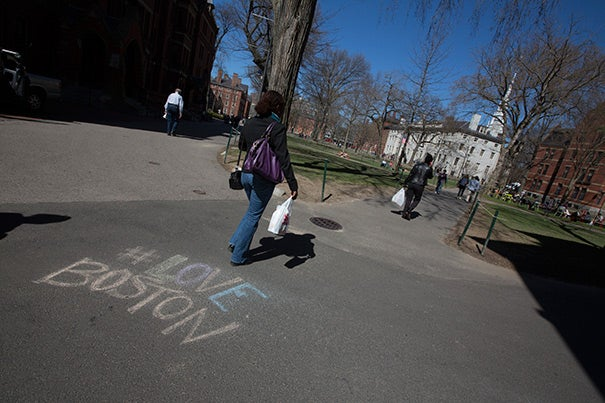A Twitter hashtag — #LoveBoston — was written on the sidewalk in Harvard Yard. Members of the Harvard community later used the Twitter hashtag #virtualvisitas to reach out to incoming freshmen who had planned to attend Visitas, which was canceled due to the lockdown.