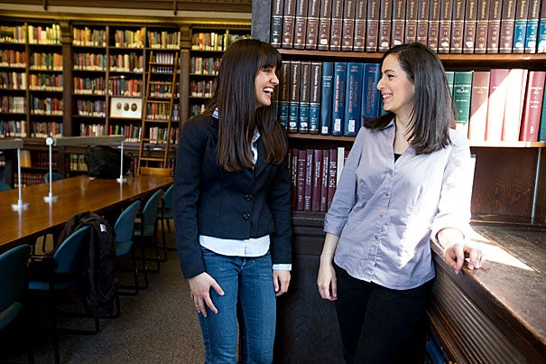 "Lena Awwad '13 (right) won the 2013 Harvard College Women's Leadership Award for an op-ed she co-authored with  Shatha I. Hussein '14. The Harvard students focused on SAT exams being withheld from Palestinian students in the West Bank. Because of their efforts, ""at least one of those students who was able to take the SATs will attend Harvard next year,"" said Gina Helfrich, director of the Harvard College Women's Center, which gives the award. The runner-up is Nadia Farjood '13 (left), who will intern at the White House this summer."