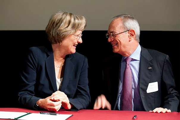 """""""Harvard is honored to be among the first signatories of the Community Compact,"""" said President Drew Faust (left). """"We have much to gain from continuing to work together to confront climate change."""" MIT President L. Rafael Reif (right) joined Faust, Cambridge Mayor Henrietta Davis, and City Manager Robert Healy in the """"Community Compact for a Sustainable Future"""" signing ceremony."""