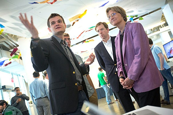 Scott Crouch '13 (from left) and Florian Mayr '13 discuss their project, Nucleik, with i-lab Managing Director Gordon Jones and President Drew Faust.