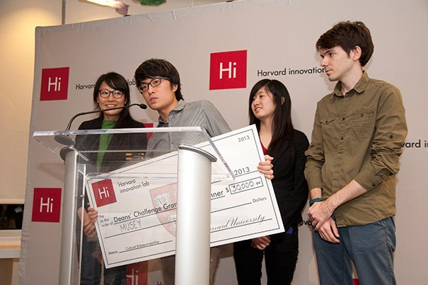 Hokan Wong (at podium) addressed the audience on behalf of the winning team:  Judy Fulton (from left), Wong, Lucy Cheng '17, and Wes Thomas. The group developed an online platform called Musey. Musey helps people find art performances in their vicinity. Their vision is what captivated the judges and landed the team $30,000 and the grand prize in the Deans' Cultural Entrepreneurship Challenge.