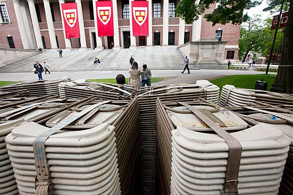 Stacks of chairs wait to be assembled in Tercentenary Theatre for Commencement.