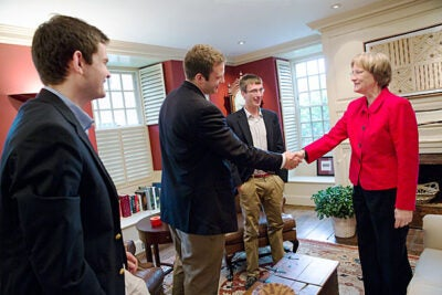 President Drew Faust greets Team Nucleik, the grand prize winners of the President's Challenge for social entrepreneurship. The team includes Scott Crouch '13 (from left), Matthew Polega '13, and Florian Mayr '13.
