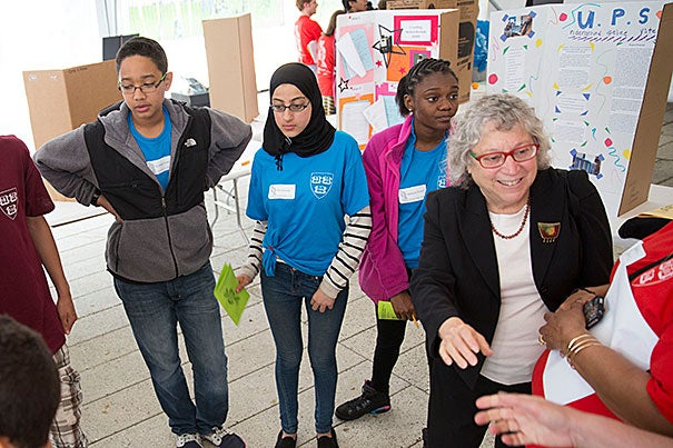 """Bukhaari Farah (from left), Hend Elcatta, and Makayla Durant, all Putnam Avenue Upper School students, met Cambridge Mayor Henrietta Davis (right). """"Things need to be discovered and changed, and you're the ones that are going to lead the way,"""" Davis said."""
