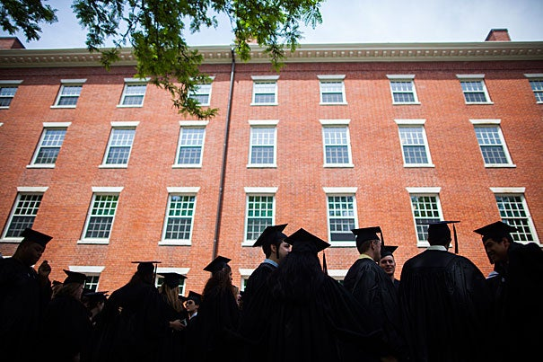 The Class of 2013 lines up to process into the Memorial Church for Baccalaureate Service. Restricted to members of the graduating class, the service is intended as a farewell to seniors from the president and clergy, in a less formal setting than that on Commencement Day. Stephanie Mitchell/Harvard Staff Photographer