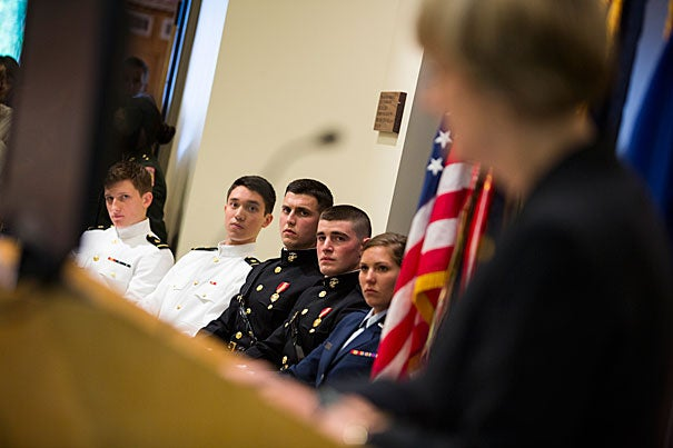 Colin Dickinson (from left), Christian Yoo, Gavin Pascarella, Brian Furey, and Courtney Diekema listened as President Drew Faust praised the students for their dedication and commitment to serve in the military.