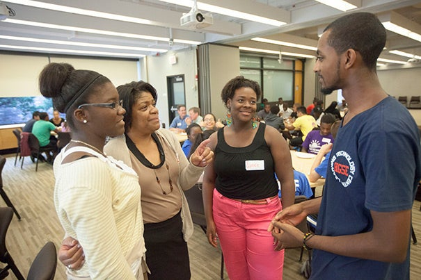 Last summer, students talked with Lisa Maxwell (second from left), assistant director of employment at HGSE, about the benefits of the program and where they were headed next. Thelora Marseille (from left), was going to the University of Massachusetts, Boston; Eunice Offre was bound for Colby-Sawyer College; and Tewodrose Woldemariam was set to attend Regis College.