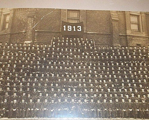 The Class of 1913 assembled on the Kirkland Street side of Memorial Hall for a class portrait. Among the June 19 graduates were editor and art collector Scofield Thayer, Eleanor Roosevelt's youngest brother, and a 14-year-old from Turkey-in-Asia. About 65 percent of the class — 375 students — served during World War I.