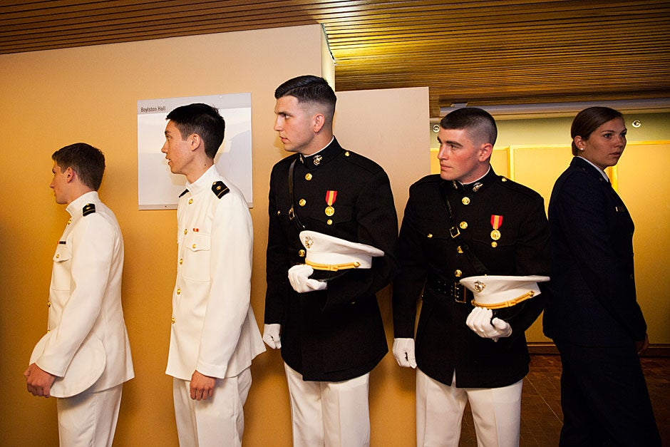 Colin Dickinson (from left), Christian Yoo, Gavin Pascarella, Brian Furey, and Courtney Diekema are pictured before the ROTC Commissioning Ceremony inside Boylston Hall. Stephanie Mitchell/Harvard Staff Photographer