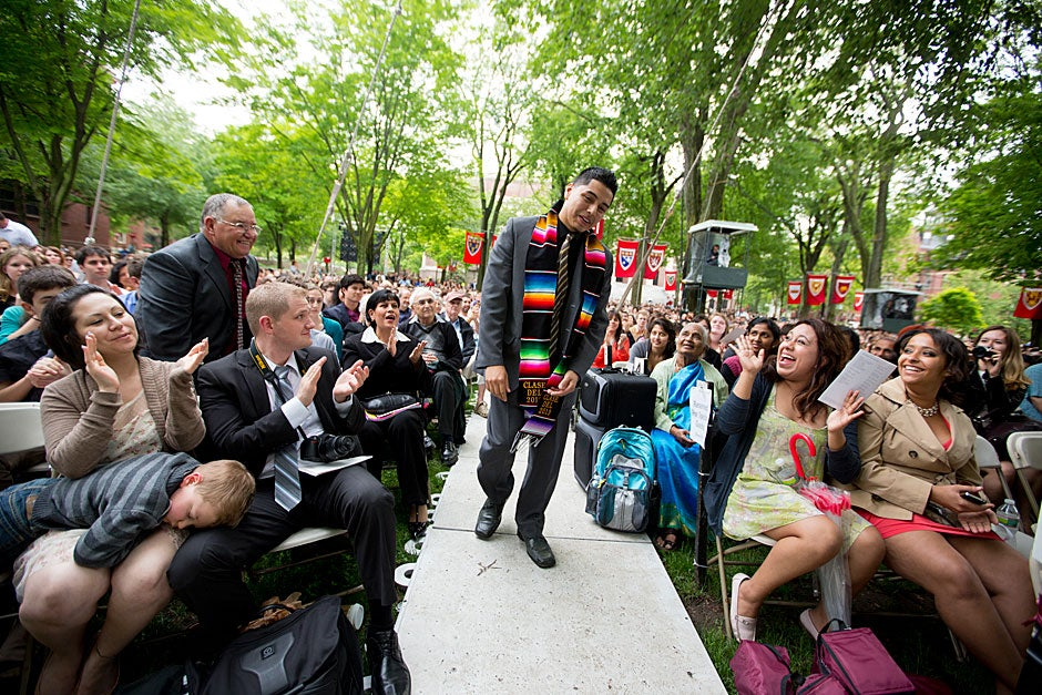 Victor Flores Jr. walks to accept the Ames Award during Class Day festivities. The Ames Award honors an unsung hero of the graduating class. Rose Lincoln/Harvard Staff Photographer