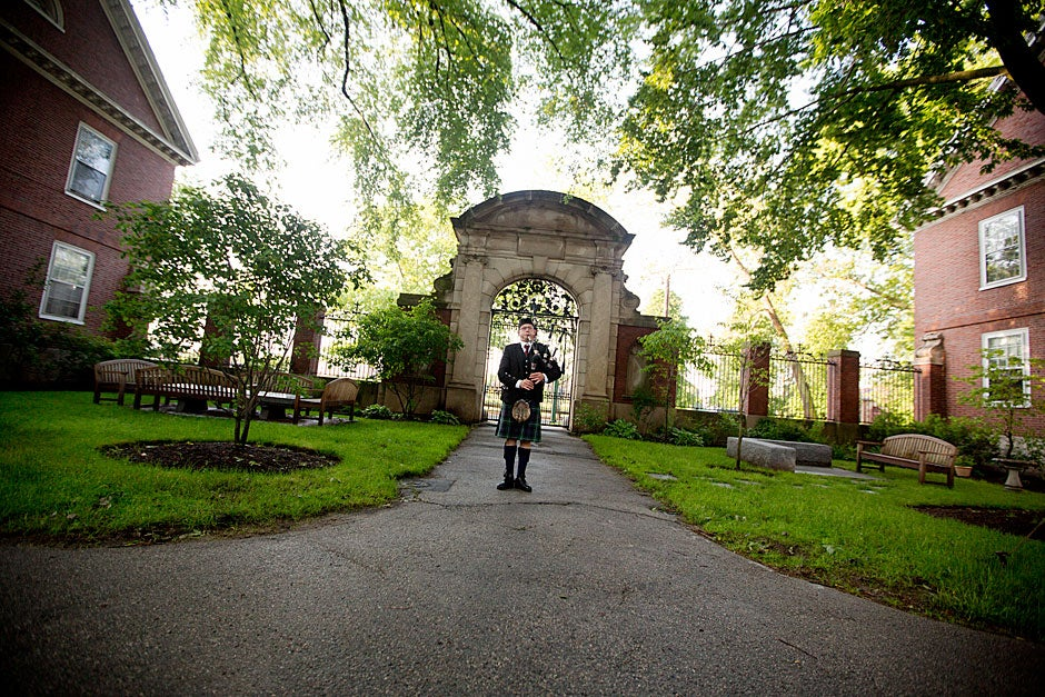 A lone bagpiper stands before Eliot House in the minutes leading up to Harvard's 362nd Commencement. Rose Lincoln/Harvard Staff Photographer