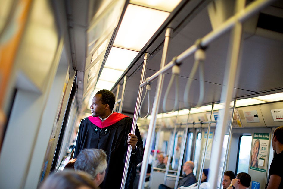 Extension School graduate Abate Kenna rides the Red Line into Harvard on Commencement morning. Rose Lincoln/Harvard Staff Photographer