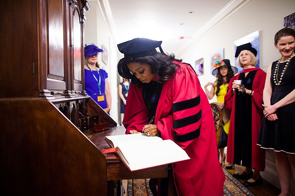 Commencement speaker Oprah Winfrey signs the guest book in Massachusetts Hall. Stephanie Mitchell/Harvard Staff Photographer