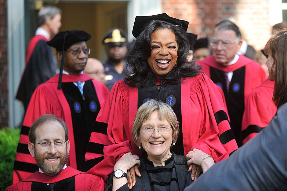 Provost Alan M. Garber, Oprah Winfrey, and President Drew Faust share a light moment during their photo op outside Massachusetts Hall. Jon Chase/Harvard Staff Photographer