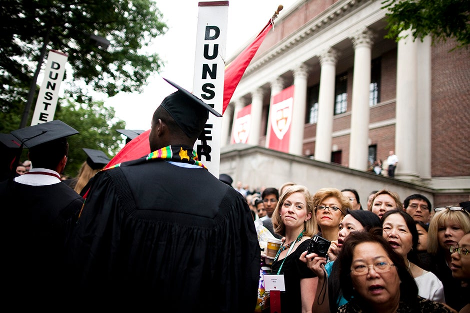 The Morning Exercises take place in Tercentenary Theatre. Family members watch graduates process in front of the steps of Widener Library during the Commencement ceremony of 2010. Stephanie Mitchell/Harvard Staff Photographer