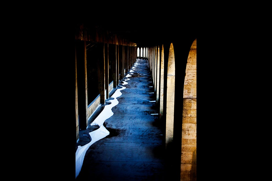 The curve of the pillars and the curve of fallen snow are outlined against a Harvard Stadium walkway. Rose Lincoln/Harvard Staff Photographer