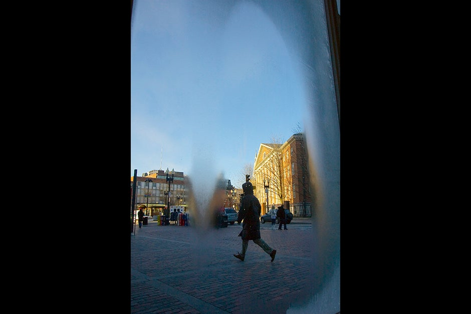 Look through a frosted window in subzero temperatures to see winter skies in Harvard Square and at Dudley House, beyond. Kris Snibbe/Harvard Staff Photographer
