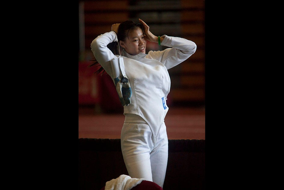 Felicia  Sun, '13 of the Harvard Fencing team competes during the NCAA Fencing Championships, held in the Gordon Track and Field Center at Harvard University.  Staff Photo Kris Snibbe/Harvard University