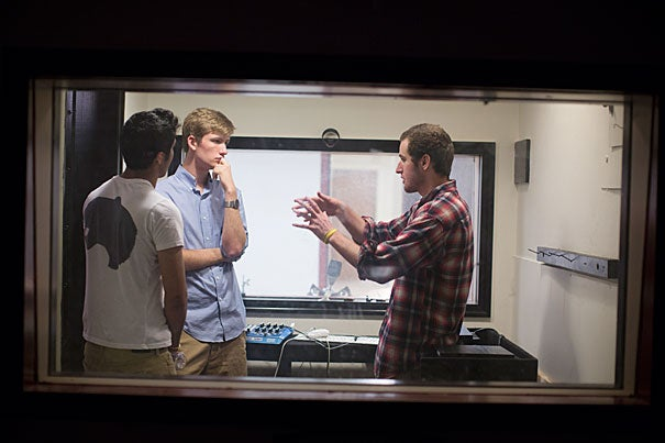 Rashad Hossain '16 (from left), Dylan Perese '16, and Matt Sheets '15 are involved with the fundraising and rebuilding of Quad Sound Studios in Holmes Hall, which closed years ago after a flood.
