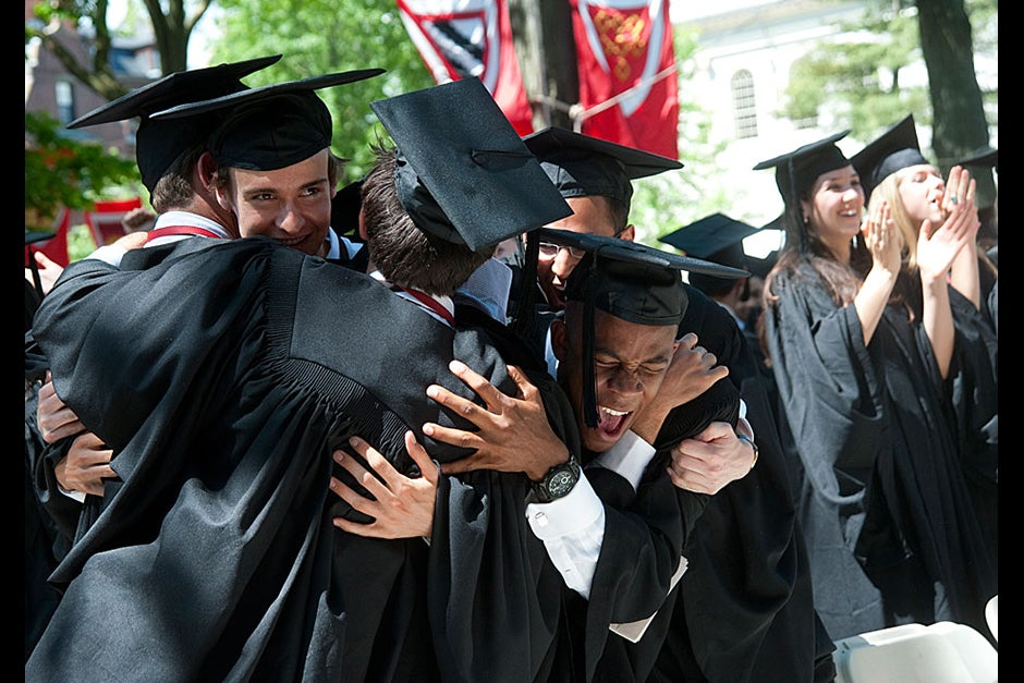During Morning Exercises, Evan Covington '12 (center) celebrates with fellow summa cum magnum graduates. Jon Chase/Harvard Staff Photographer