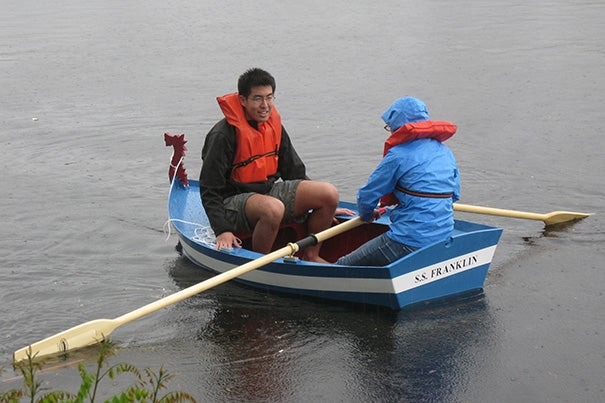 The Charles was the perfect place for Phillip Yao and Jessica Rucinski to test a boat they helped build as part of a project spearheaded by Professor Melissa Franklin.