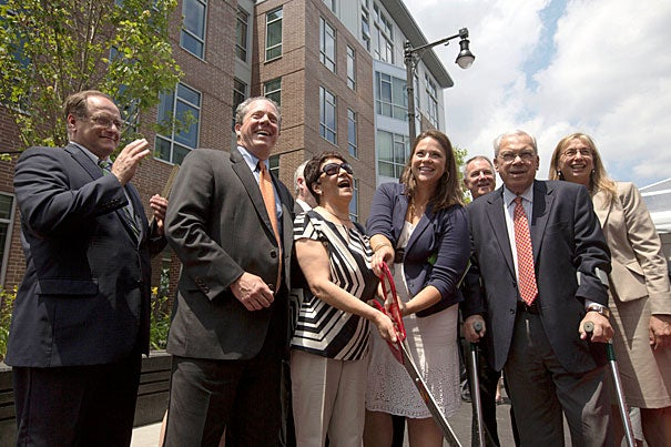 Congressman Michael E. Capuano (from left), Community Builders Inc. President and CEO Bart Mitchell, Charlesview resident Elsa Rojas, former Charlesview resident Angela Holm, Mayor Thomas M. Menino, and Housing and Urban Development Regional Administrator Barbara Fields cut the ribbon on the new Charlesview Residences at Brighton Mills.